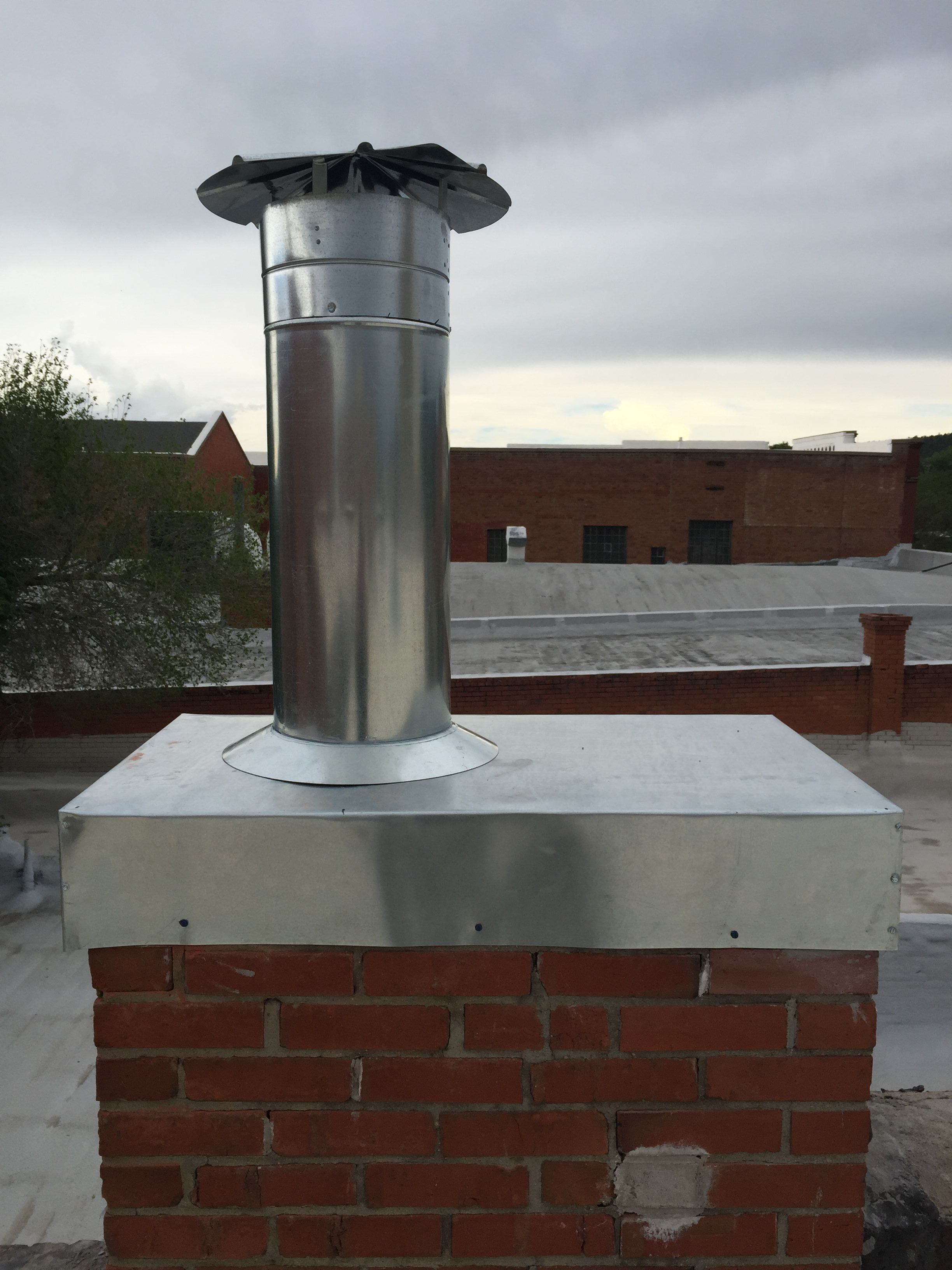 Chimney Cap and Vent Penetration